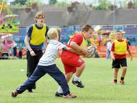 Young boys play a game of touch rugby