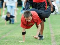 A young man takes part in a wheelbarrow race