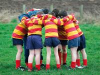 A rugby team in a huddle